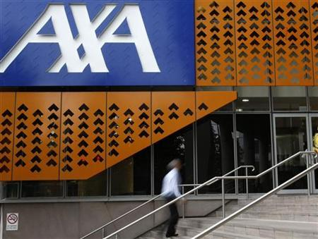 An office worker walks past the AXA Asia Pacific headquarters in Melbourne December 17, 2009. REUTERS/Mick Tsikas