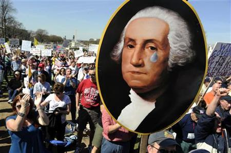 A protestor holds a picture of President George Washington crying as several groups hold a ''Kill the Bill'' rally against health care legislation on Capitol Hill, March 20, 2010. REUTERS/Jonathan Ernst