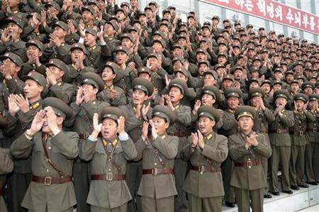North Korean soldiers applaud during a visit by their leader Kim Jong-il at the 1224 military unit at an undisclosed place in North Korea, in an undated picture released in November 2009. REUTERS/KCNA