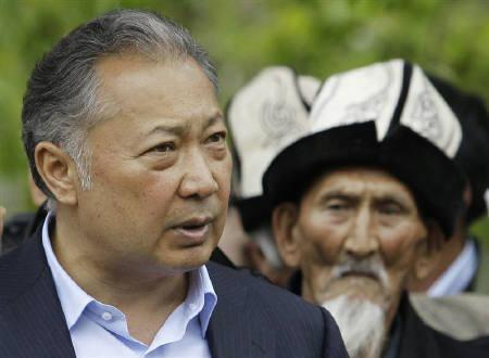 Kyrgyz President Kurmanbek Bakiyev (L) talks to his supporters in Teyyit April 15, 2010. Kyrgyzstan's new rulers stamped their authority on Wednesday on the southern stronghold of Bakiyev, who issued a defiant statement from exile saying he was still president. REUTERS/Denis Sinyakov/Files