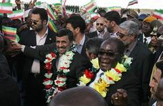 <p>Zimbabwe President Robert Mugabe (R) and his Iranian counterpart Mahmoud Ahmadinejad (L) are welcomed at Harare International Airport, April 22, 2010.REUTERS/Philimon Bulawayo</p>
