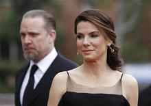 <p>Actress Sandra Bullock and husband Jesse James arrive at the 41st Annual NAACP Image Awards at the Shrine auditorium in Los Angeles, February 26, 2010. REUTERS/Danny Moloshok</p>