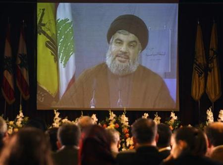 Lebanon's Hezbollah leader Sayyed Hassan Nasrallah speaks via a giant screen during a news conference announcing the party's new political strategy in Beirut November 30, 2009. REUTERS/Sharif Karim