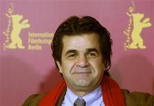 <p>Iranian director Jafar Panahi poses during a photocall to present his film 'Offside' running in competition at the 56th Berlinale International Film Festival in Berlin February 17, 2006. REUTERS/Arnd Wiegmann</p>