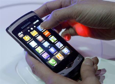 The new Samsung 'Wave' smartphone is seen during the Mobile World Congress in Barcelona February 14, 2010. REUTERS/Albert Gea/Files