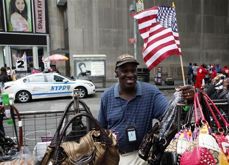 Street vendor Duane Jackson stands at his table a day after an alleged homemade bomb was found in a car directly behind where he is standing in Times Square in New York May 2, 2010. REUTERS/Chip East