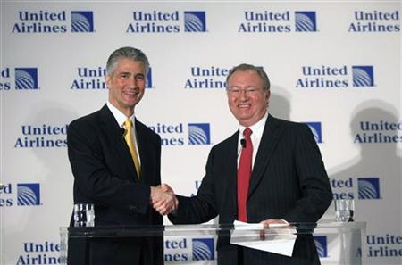 Jeff Smisek (L), Chairman, President and Chief Executive Officer of Continental Airlines and Glenn Tilton, Chairman, Chief Executive Officer and President of UAL Corporation shake hands during a news conference announcing the merger between Continental Airlines and United Airlines in New York, May 3, 2010. REUTERS/Shannon Stapleton
