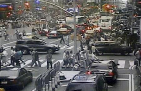 A surveillance photo captured in Times Square shows a Nissan Pathfinder sports utility vehicle (R) containing a bomb in this New York Police Department image released to Reuters on May 2, 2010. REUTERS/New York Police Department/Handout