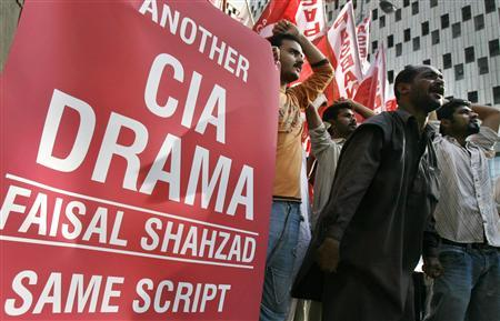 Supporters of Pakistan Islamist party Pasban hold a placard and chant anti-American slogans during a protest in Karachi May 6, 2010, against the arrest of Faisal Shahzad, a Pakistani-American held in New York on suspicion of driving a bomb-laden car into Times Square. REUTERS/Athar Hussain
