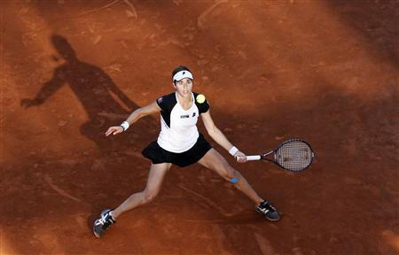 Maria Jose Martinez Sanchez of Spain eyes the ball as she hits a return to Jelena Jankovic of Serbia during their final match at the Rome Masters tennis tournament in Rome May 8, 2010. REUTERS/Stefano Rellandini