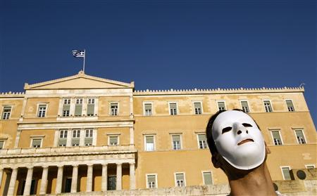 A demonstrator wearing a mask protests against the government's austerity measures and the violence that erupted at a rally last Wednesday, in front of the parliament in Athens, May 9, 2010. REUTERS/Yiorgos Karahalis