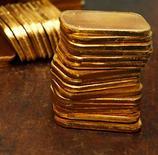 <p>C'est la dernière trouvaille des pays du Golfe toujours à la recherche de sensations fortes pour milliardaires: un distributeur automatique d'or vient d'être installé dans un palace d'Abou Dhabi. /Photo d'archives/REUTERS</p>