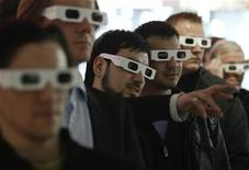 <p>Visitors wear 3D glasses as they watch a presentation at the Deutsche Telekom stand on the CeBIT computer fair in Hanover March 2, 2010. REUTERS/Fabrizio Bensch</p>