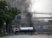 "<p>Anti-government ""red shirt"" protesters use a petrol truck to block a road during clashes with soldiers in Bangkok May 17, 2010. REUTERS/Kerek Wongsa</p>"