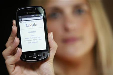 A T-Mobile employee holds a new android-based smartphone in London September 3, 2009. REUTERS/Stefan Wermuth