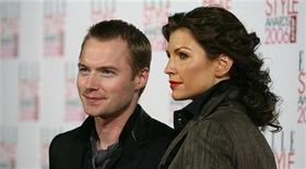 <p>Singer Ronan Keating and his wife Yvonne arrive for the Elle Style Awards at the Atlantis Gallery in east London, February 20, 2006. REUTERS/Eddie Keogh</p>