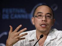 <p>Director Apichatpong Weerasethakul attends a news conference for the film Lung Boonmee Raluek Chat (Uncle Boonmee Who Can Recall his Past Lives) in competition at the 63rd Cannes Film Festival May 21, 2010. REUTERS/Yves Herman</p>