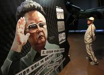 <p>A man looks at a portrait of North Korean leader Kim Jong-il during the Korean War exhibition at the Korean War Memorial Museum in Seoul May 23, 2010. REUTERS/Jo Yong-Hak</p>
