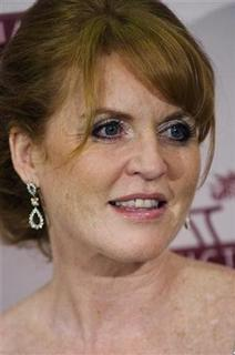 Britain's Duchess of York Sarah Ferguson poses for photographers at her arrival for the premiere of ''Young Victoria'' by Canadian director Jean-Marc Vallee in Paris July 7, 2009. REUTERS/Gonzalo Fuentes