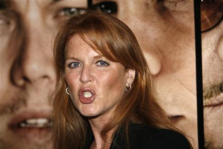 Britain's Duchess of York Sarah Ferguson tries to quiet down photographers at an industry screening of ''The Departed'' at the Director's Guild theatre in Los Angeles October 5, 2006. REUTERS/Mario Anzuoni