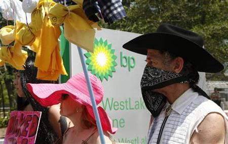 Codepink activists stage a demonstration calling for British Petroleum to clean up the Gulf of Mexico oil spill, during a protest outside BP Plc's corporate headquarters building in Houston May 24, 2010. The U.S. government piled pressure on BP to clean up a ''massive environmental mess'' in the Gulf of Mexico amid growing anger at the oil giant's failure to contain a five-week-old oil spill. The company insisted it was doing all it could to try to shut off a blown-out oil well spewing hundreds of thousands of gallons (liters) of oil into the Gulf every day. REUTERS/Richard Carson