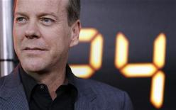 "<p>Cast member Kiefer Sutherland poses at the party for the television series finale of ""24"" in Los Angeles April 30, 2010. REUTERS/Mario Anzuoni</p>"