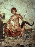 <p>Dipinto su un muro a Pompei, foto d'archivio. REUTERS/Handout</p>