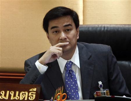Thailand's Prime Minister Abhisit Vejjajiva attends a parliamentary session to discuss the country's 2011 budget plan at parliament in Bangkok May 27, 2010. REUTERS/Chaiwat Subprasom