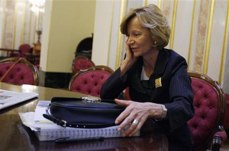 Spain's Economy Minister Elena Salgado speaks on a mobile phone during a break before voting for the government's austerity plan at the Parliament in Madrid, May 27, 2010. REUTERS/Stringer