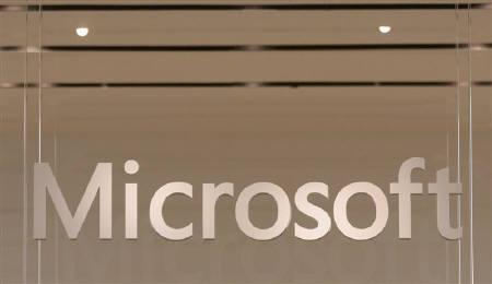The Microsoft logo hangs from a window during the grand opening of Microsoft's first retail store in Scottsdale, Arizona October 22, 2009. REUTERS/Joshua Lott/Files
