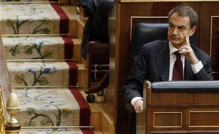 Spain's Prime Minister Jose Luis Rodriguez Zapatero sits in his seat before voting for the government's austerity plan at the Parliament in Madrid May 27, 2010. REUTERS/Sergio Perez
