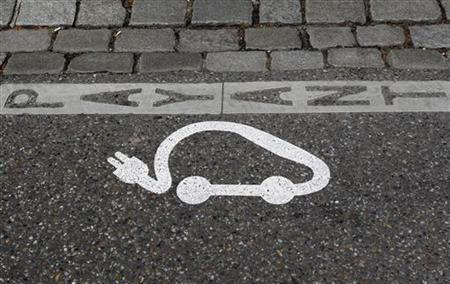 The pictogram of an electric car is painted on a parking space in Strasbourg, April 26, 2010. REUTERS/Vincent Kessler