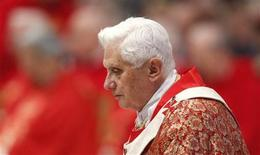 <p>Pope Benedict XVI walks as he leads the Pentecostal mass in Saint Peter's Basilica at the Vatican, May 23, 2010. REUTERS/Max Rossi</p>