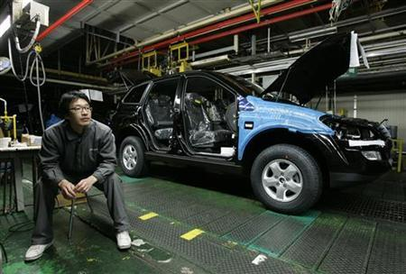 A Ssangyong Motor worker sits beside the company's assembly line, which has been stopped, at its factory in Pyeongtaek, about 70 km (40 miles) south of Seoul, in this January 12, 2009 file photo. REUTERS/Jo Yong-Hak/Files