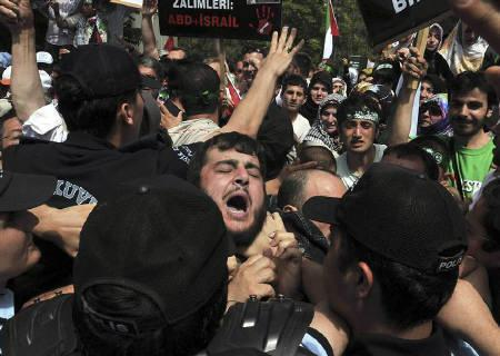 A demonstrator shouts as he and others are surrounded by riot police during a protest against Israel in front of the residence of Israeli Ambassador to Turkey Gabby Levy in Ankara June 1, 2010. REUTERS/Stringer