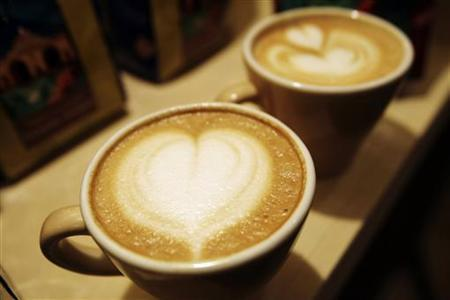 Cups of cappuccino sit on a table in Guatemala City in this February 26, 2010 file photo.  REUTERS/Daniel Leclair