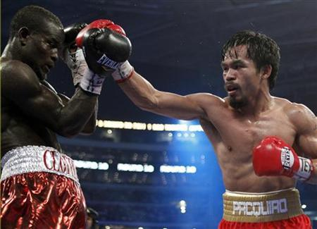 Manny Pacquiao of the Philippines hits Ghana's Joshua Clottey (L) during the tenth round of their WBO welterweight championship fight at Cowboys Stadium in Arlington, Texas, March 13, 2010. REUTERS/Jeff Haynes