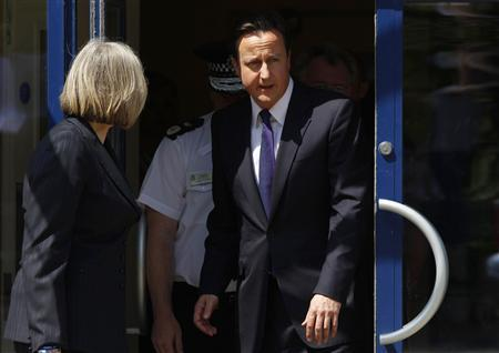 Prime Minister David Cameron leaves Workington police station in Workington June 4, 2010. REUTERS/David Moir