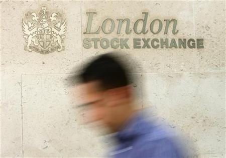 A man passes the London Stock Exchange in central London May 21, 2008. REUTERS/Luke MacGregor