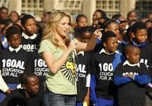 <p>Colombian pop star Shakira speaks to school children at the Isu'lihle primary school in Soweto, June 9, 2010. REUTERS/Howard Burditt</p>