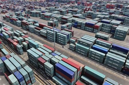 Piles of containers are seen at a port in Yingkou, Liaoning province June 10, 2010. China's exports rose 48.5 percent in May from a year earlier and imports were up 48.3 percent, the General Administration of Customs said on Thursday. REUTERS/Sheng Li