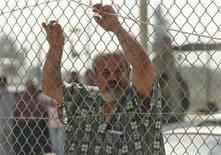 <p>A Palestinian man waits to cross to Egypt at the Rafah border crossing in the southern Gaza Strip June 1, 2010. REUTERS/Mohammed Salem</p>