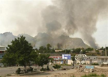 Smoke rises from the residential area of the city of Osh June 12, 2010. REUTERS/Alexei Osokin
