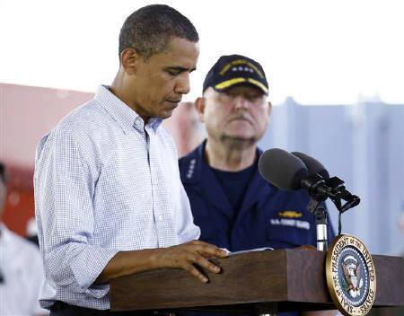 U.S. President Barack Obama makes remarks on the BP oil spill beside National Incident Commander Admiral Thad Allen at the Theodore Staging Facility in Theodore, Alabama, June 14, 2010.  REUTERS/Jim Young