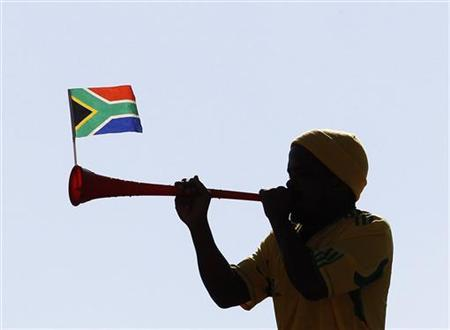 A soccer fan blows a vuvuzela as he watches the New Zealand practice session at Sinaba Stadium in Benoni, near Johannesburg June 12, 2010. REUTERS/Daniel Munoz