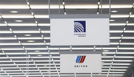 A Continental Airlines sign is seen next to a United Airlines sign in Chicago's O'Hare International Airport May 3, 2010. REUTERS/John Gress