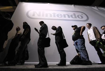 Attendees wait in line at the Nintendo display at the E3 Media & Business Summit in Los Angeles on June 15, 2010. REUTERS/Phil McCarten