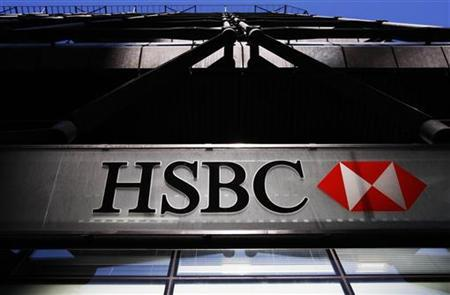 An HSBC bank logo is highlighted by the sun in London March 1, 2010. REUTERS/Luke MacGregor