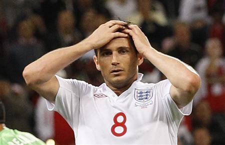 England's Frank Lampard reacts after missing a chance on goal during their 2010 World Cup Group C match against Algeria at Green Point stadium in Cape Town June 18, 2010. REUTERS/Darren Staples