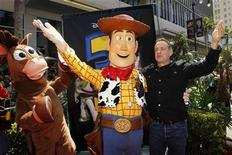 "<p>Actor Tom Hanks (R) waves at fans with character Woody (C), whose voice he plays in the film, and character Bullseye (L) as he arrives at the world premiere of Disney Pixar's ""Toy Story 3"" at the El Capitan Theatre in Hollywood, California June 13, 2010. REUTERS/Danny Moloshok</p>"